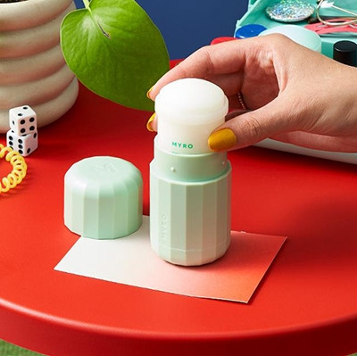 The Start Ups Perfecting Refillable Deodorants Myro - hand inserting deodorant refill into a case