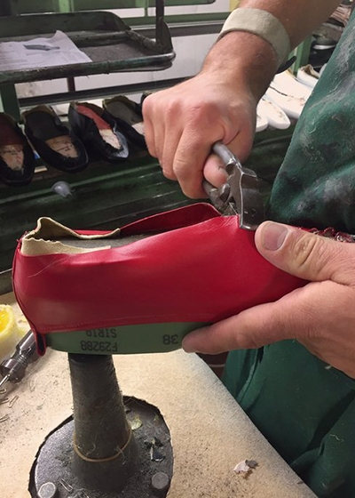 Made to order Shoes: The Sustainable Footwear To Invest In ESSEN The Label Foundation Flats in red being made by Italian Artisan
