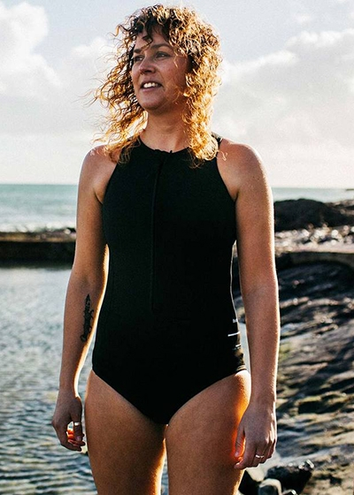 The ultimate sustainable swimsuit guide Finisterre Nieuwland 2e Yulex black one piece swimsuit